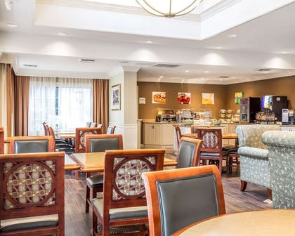 Enjoy breakfast in this seating area | Quality Suites Buckhead Village