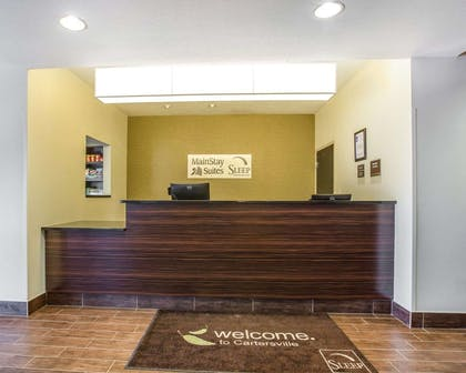 Front desk with friendly staff   MainStay Suites Cartersville - Emerson Lake Point