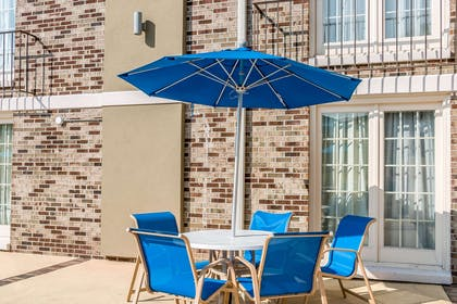Outdoor pool with sitting area | Comfort Inn