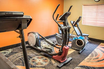 Fitness center with cardio equipment and weights | Clarion Inn & Suites Savannah Midtown