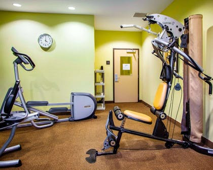 Fitness center with cardio equipment and weights | Suburban Extended Stay Hotel C
