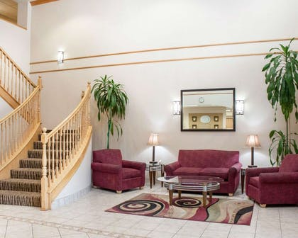 Spacious lobby with sitting area   Comfort Suites Airport