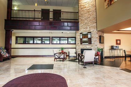 Spacious lobby with sitting area | Comfort Suites Elgin