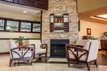 Sitting area with fireplace | Comfort Suites Elgin