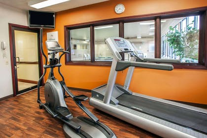 Exercise room with cardio equipment and weights | Comfort Suites Elgin