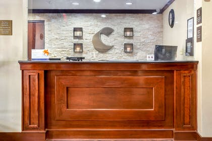 Front desk with friendly staff   Quality Inn