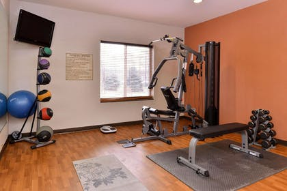 Exercise room with cardio equipment and weights | Comfort Suites Urbana Champaign, University Area