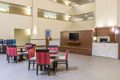 Enjoy breakfast in this seating area | Comfort Inn Collinsville