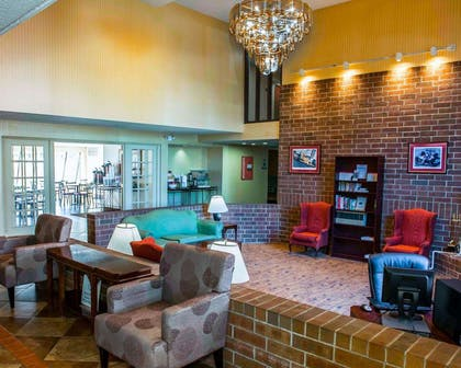 Spacious lobby with sitting area | Comfort Inn & Suites North at the Pyramids