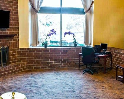 Lobby with fireplace | Comfort Inn & Suites North at the Pyramids