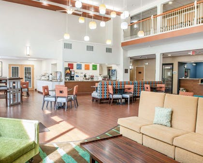 Spacious lobby with sitting area | Comfort Suites Elkhart