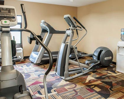 Exercise room with television | Quality Inn & Suites Greenfield I-70
