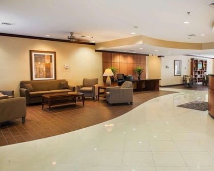 Spacious lobby with sitting area | Comfort Suites Southport