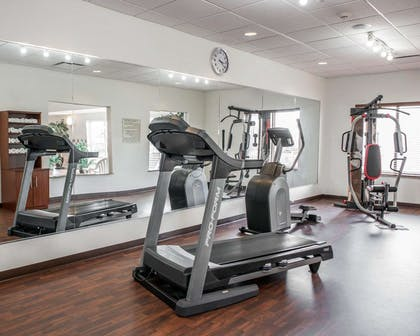 Exercise room with cardio equipment and weights | Comfort Suites near Indianapolis Airport