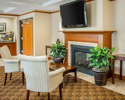 Relax by the fireplace in the lobby | Comfort Suites French Lick