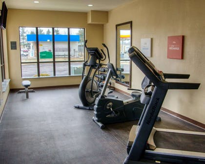 Fitness center with television | Comfort Suites