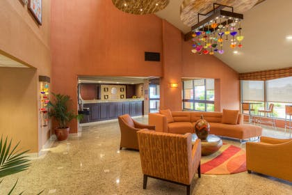 Spacious lobby with sitting area | Comfort Inn & Suites Evansvile Airport