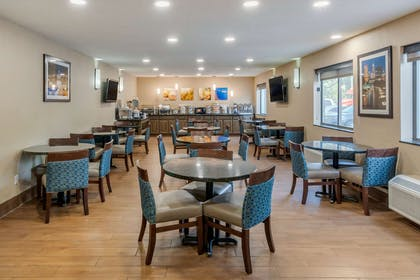 Enjoy breakfast in this seating area   Comfort Inn South