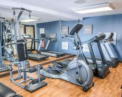 Exercise room with cardio equipment and weights | Comfort Suites South