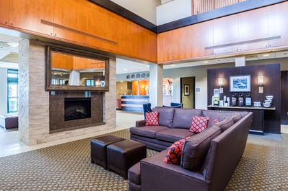Relax by lobby fireplace | Comfort Inn & Suites Logan International Airport