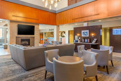 Spacious lobby with sitting area | Comfort Inn & Suites Logan International Airport