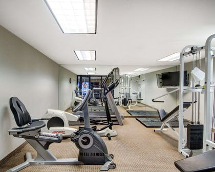 Exercise room with cardio equipment and weights | Comfort Inn Woburn