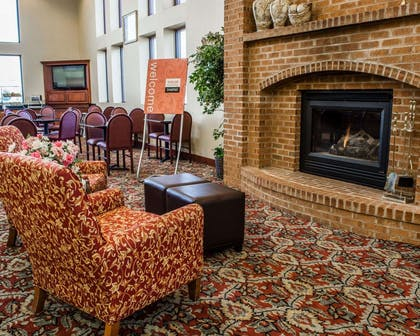 Sitting area with fireplace   Comfort Suites