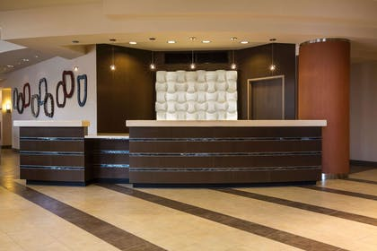 Modern front desk with a helpful and friendly staff | Cambria Hotel Rockville