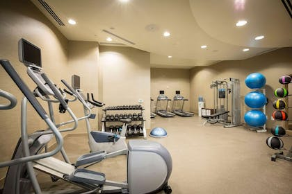 Fitness center with cardio equipment and weights | Cambria Hotel Rockville