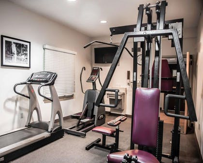Fitness center with cardio equipment and weights | Sleep Inn & Suites Edgewood Near Aberdeen Proving Grounds