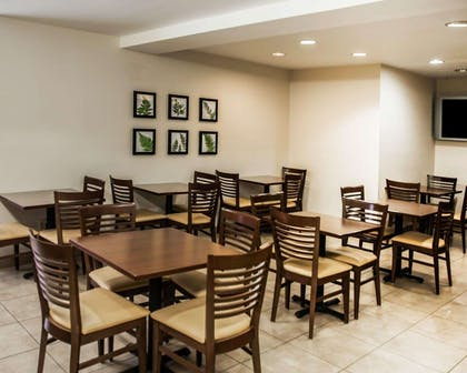 Enjoy breakfast in this seating area | Sleep Inn & Suites Edgewood Near Aberdeen Proving Grounds