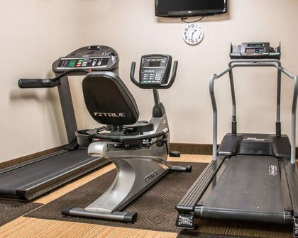 Exercise room with cardio equipment and weights | Comfort Inn & Suites and Conference Center