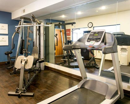 Exercise room with cardio equipment and weights | Comfort Suites Benton Harbor - St. Joseph