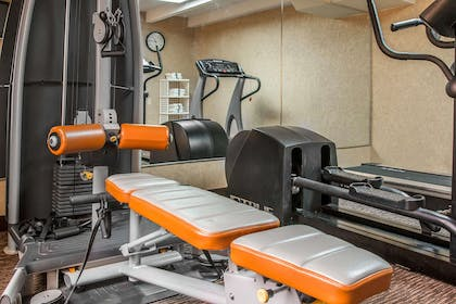 Exercise room with cardio equipment | Quality Inn