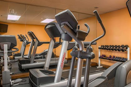 Fitness center with cardio equipment and weights | Shoreline Inn & Conference Center an Ascend Collection Hotel