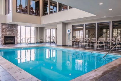 Indoor heated pool with fireplace | Shoreline Inn & Conference Center an Ascend Collection Hotel