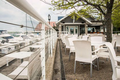 Hotel patio with lake view | Shoreline Inn & Conference Center an Ascend Collection Hotel