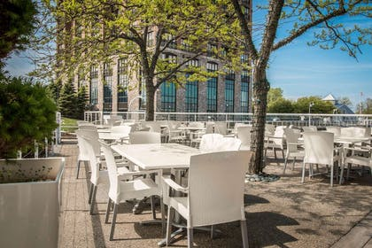 Relax on the hotel patio | Shoreline Inn & Conference Center an Ascend Collection Hotel