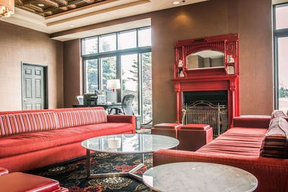 Lobby with fireplace | Shoreline Inn & Conference Center an Ascend Collection Hotel