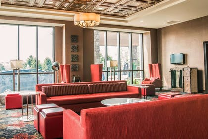 Spacious lobby with sitting area | Shoreline Inn & Conference Center an Ascend Collection Hotel