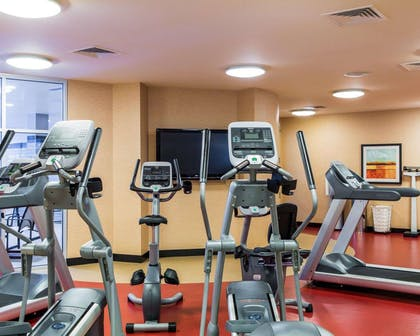 Fitness center with cardio equipment and weights | Cambria Hotel Traverse City