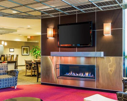 Catch up on the day in front of the large-screen media wall | Cambria Hotel Traverse City