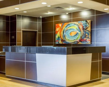 Modern front desk with a helpful and friendly staff | Cambria Hotel Traverse City
