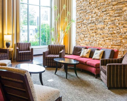 Relax in the open space lobby with club-lounge seating | Cambria Hotel Traverse City