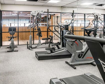 Fitness center with cardio equipment and weights | Quality Inn & Suites