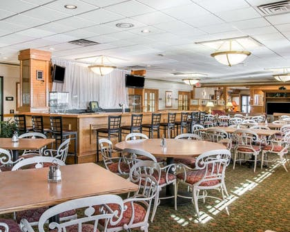 Enjoy breakfast in this spacious area | Quality Inn & Suites