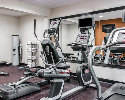 Fitness center with cardio equipment and weights | Quality Inn & Suites Warren - Detroit