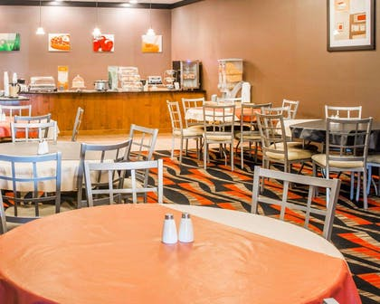 Enjoy breakfast in this seating area | Quality Inn & Suites Next to the Casino