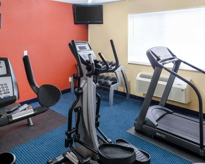 Fitness center with cardio equipment | Quality Inn