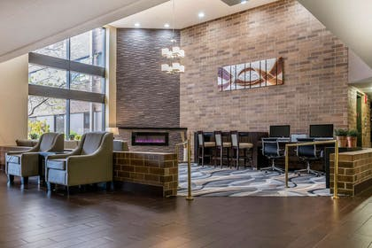 Spacious lobby with sitting area | Quality Inn & Suites Mall of America - MSP Airport